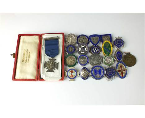 A collection of sixty-three silver and enamelled nursing medals, together with two French medals signed 'Lalique' (65)Conditi