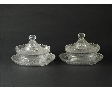 A pair of George III Irish oval cut glass butter dishes, covers and standscirca 1810of oval form, with faceted and hobnail si