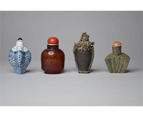 Four Chinese snuff bottles, Qing DynastyIncluding an internally painted glass bottle with polished coral stopper, 7.5cm, a bl