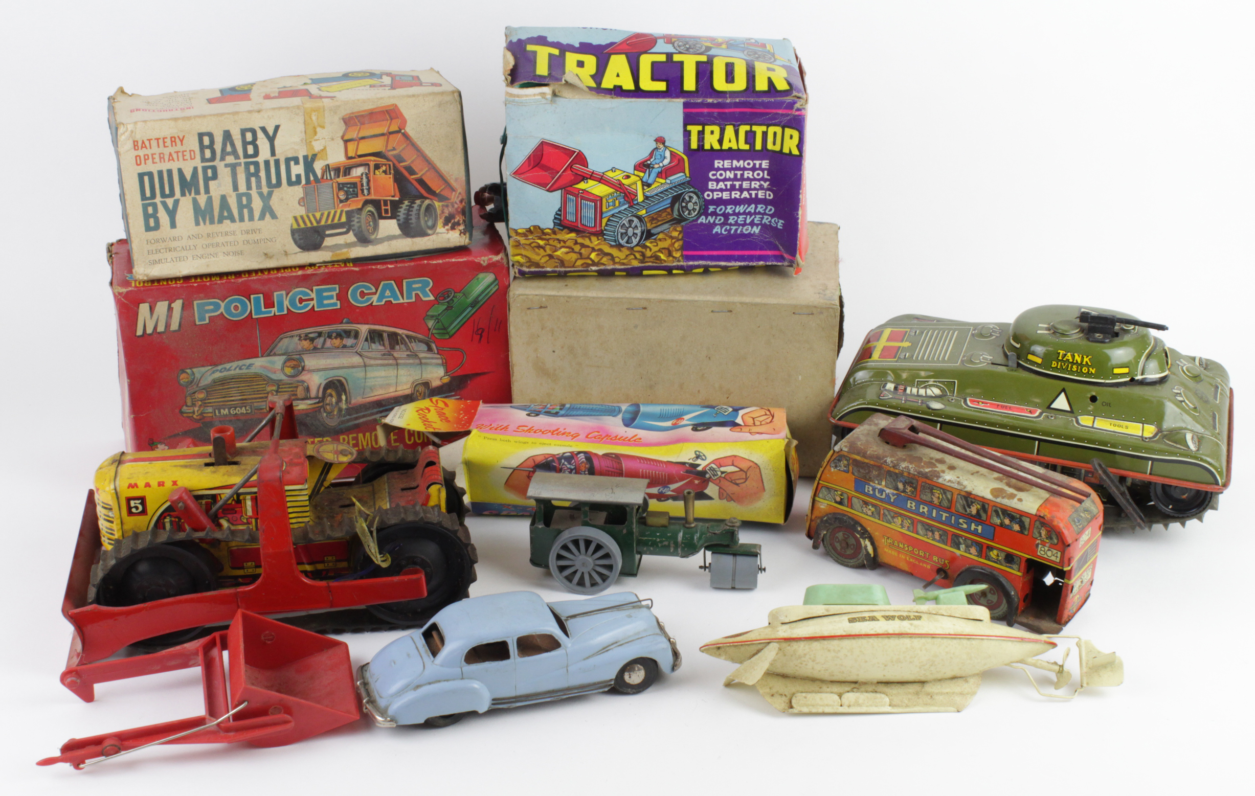 Lot 689 - Vintage Toys. A collection of vintage toys (some boxed), including Marx Battery Operated Dump Truck,