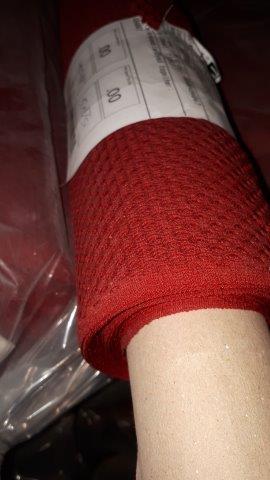 Lot 31 - Fabric red net (9 rolls)