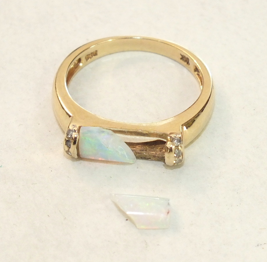 Lot 219 - A modern 14ct yellow gold ring set opal baton, (a/f, in two pieces), between diamond-set