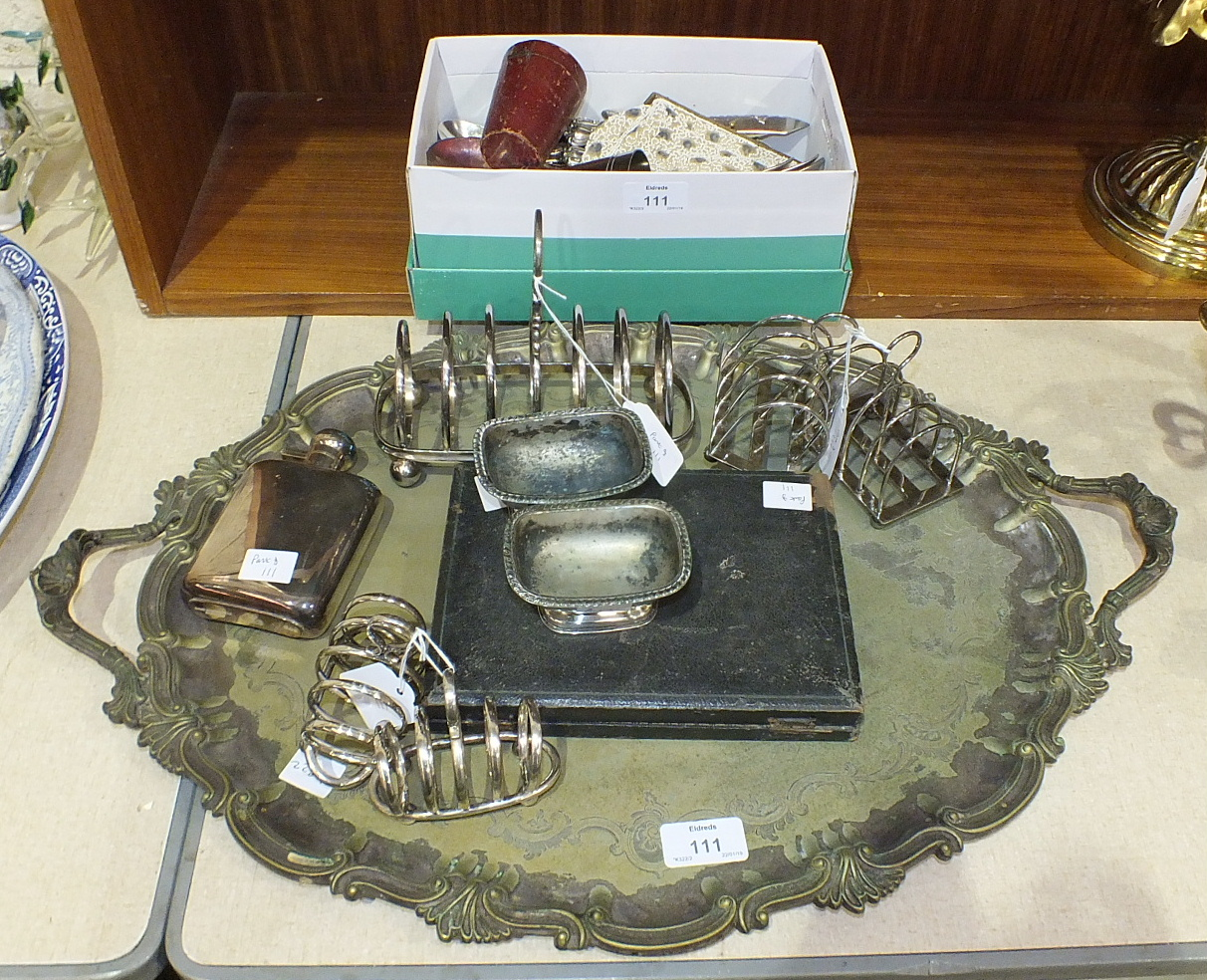 Lot 111 - A plated two-handled oval tray, 60 x 40cm, a plated toast rack, two smaller pairs of toast racks,
