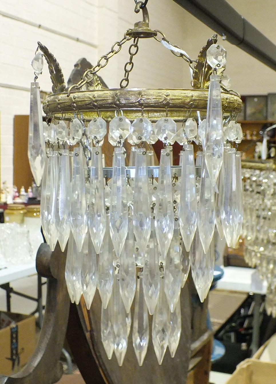 Lot 125 - A circular metal five-tier lustre-drop hanging light fitting, 46cm high, 31cm diameter and a smaller