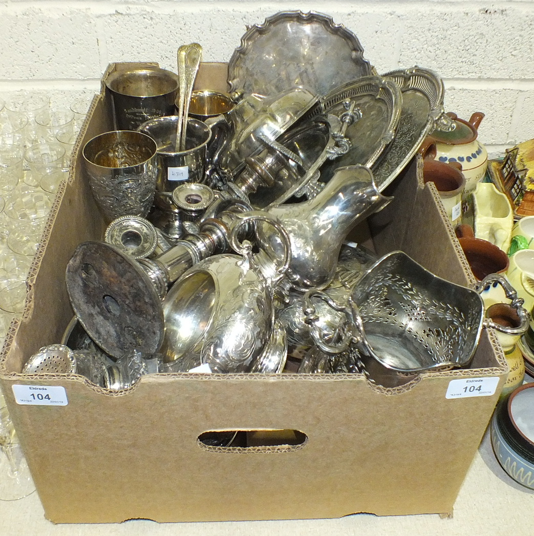 Lot 104 - A collection of plated wares, including salvers, bottle stand, candlesticks, goblets, muffin dish