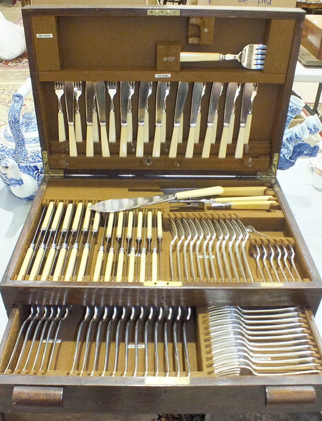 Lot 144 - A Mappin & Webb twelve-place canteen of plated cutlery in fitted oak case with drawer, (one fish