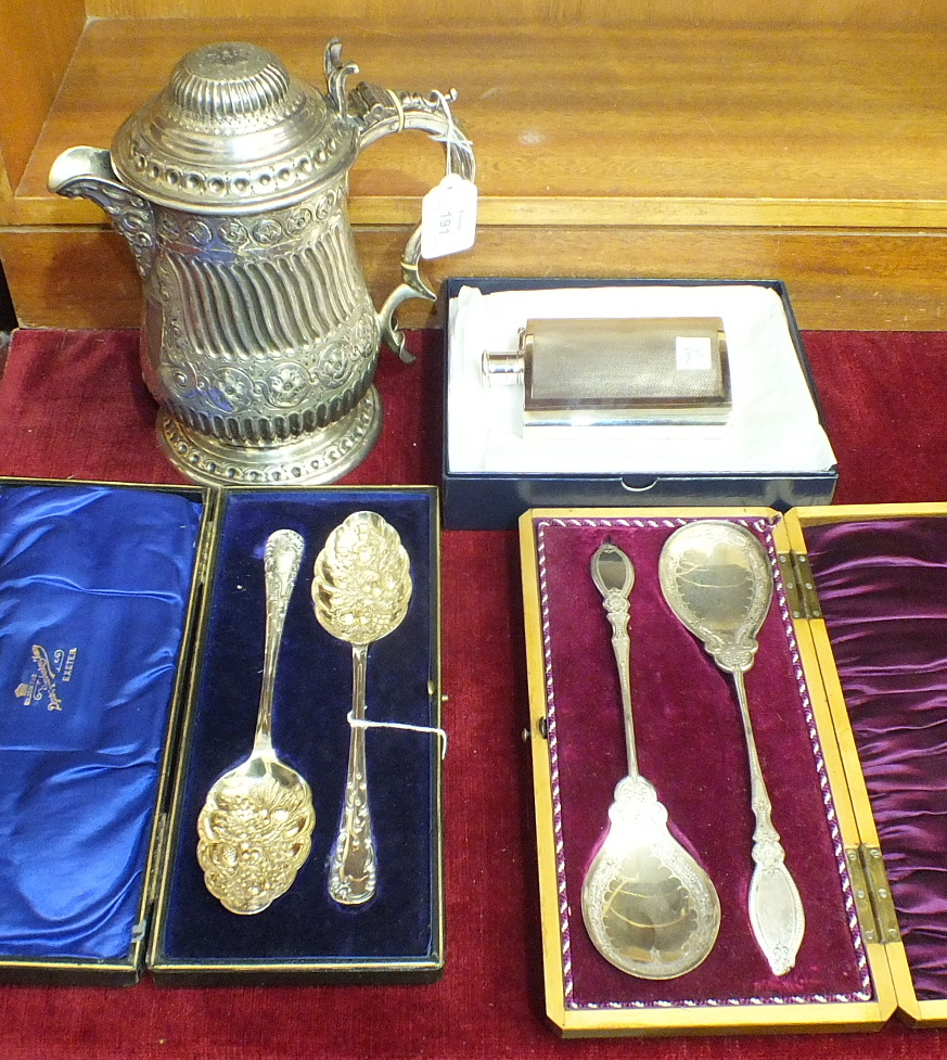 Lot 191 - A 19th century silver-plated lidded tankard, 23cm high, two cased sets of berry spoons and a