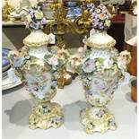 A pair of late-19th century Continental flower-encrusted vases and covers, 41cm high, (some