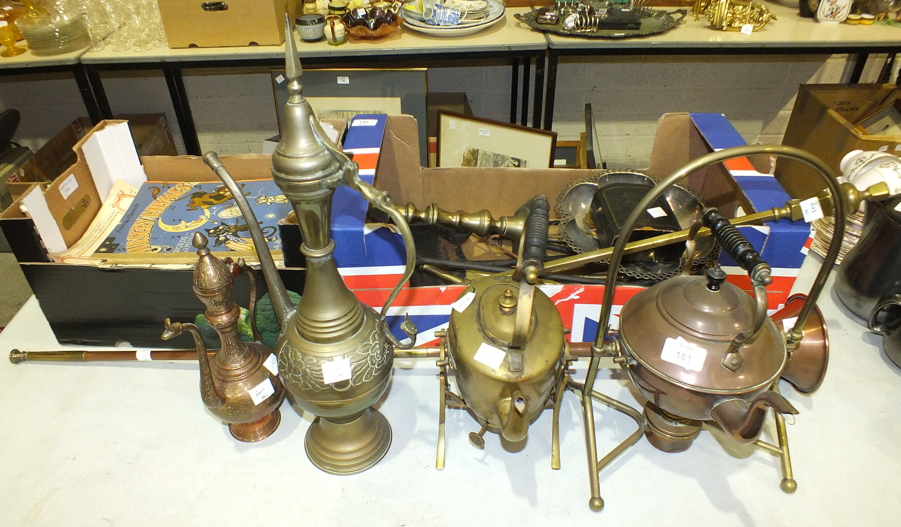 Lot 161 - A cased set of six plated napkin rings, two metal spirit kettles on stands, other metalware and