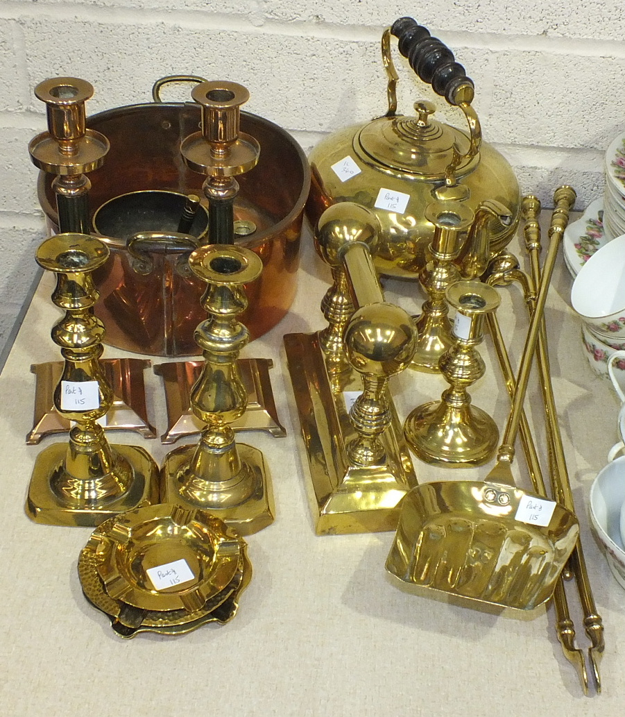 Lot 115 - A collection of brass and copper ware, including candlesticks, kettle, fire brasses, jam pots and