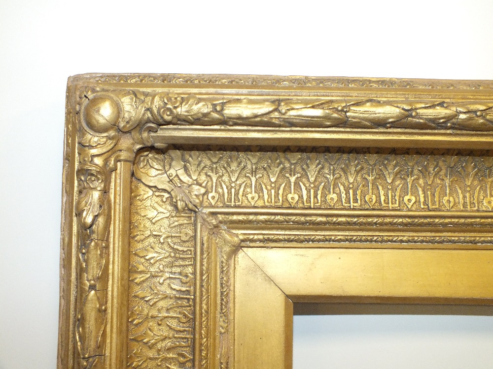 Lot 75 - A 19TH CENTURY GOLD FRAME, with acanthus leaf top edge and decorated scoop with slip, frame W 11 cm,