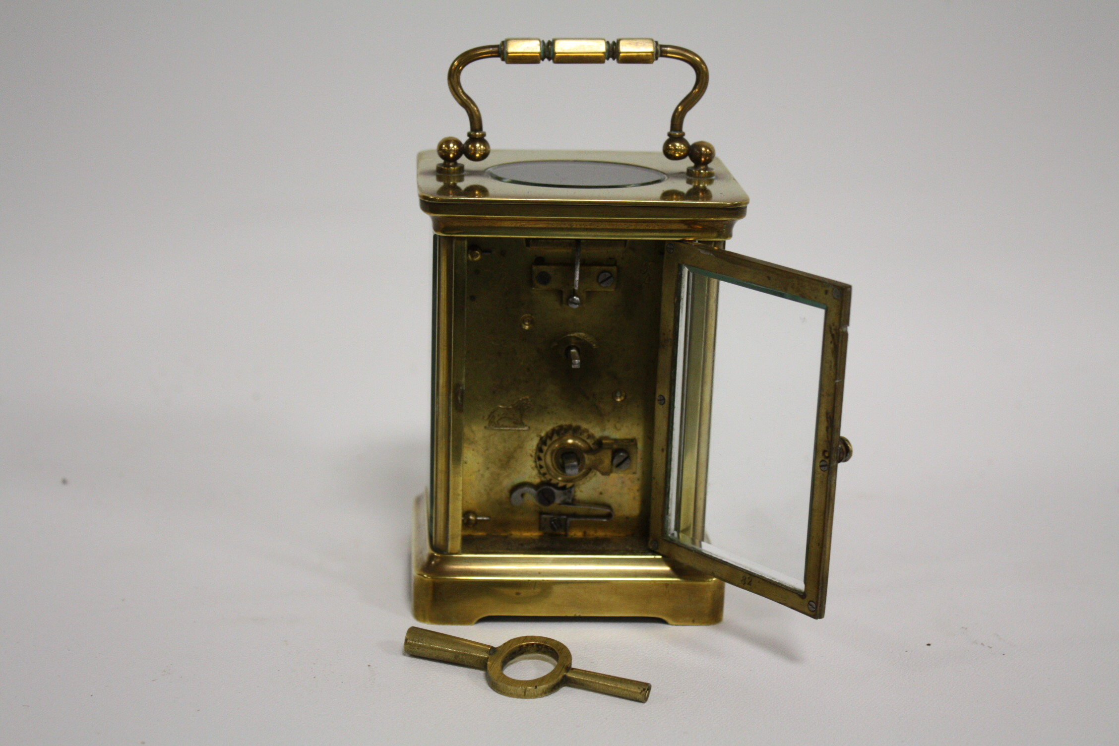 Lot 630 - A SMALL BRASS CASED DUVERDREY & BLOQUEL CARRIAGE CLOCK, the enamel dial with Roman numerals, the