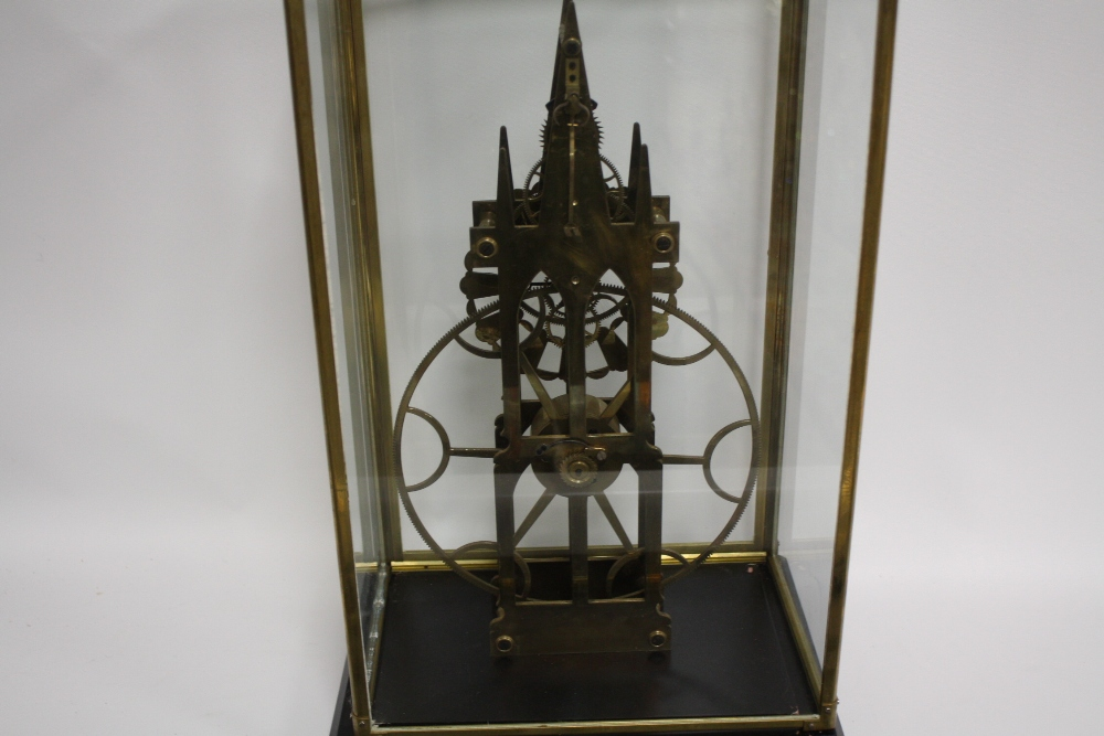 Lot 636 - AN EARLY 21ST CENTURY GLASS CASED GREAT WHEEL SKELETON CLOCK, overall case dimensions W 34 cm, H