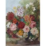 (XX). A still life study of flowers in a vase on a marble ledge, indistinctly signed lower right,