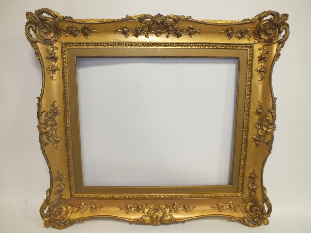 Lot 69 - A 19TH CENTURY DECORATIVE GOLD SWEPT FRAME, with gilt slip, frame W 11 cm, slip rebate 62 x 52 cm,