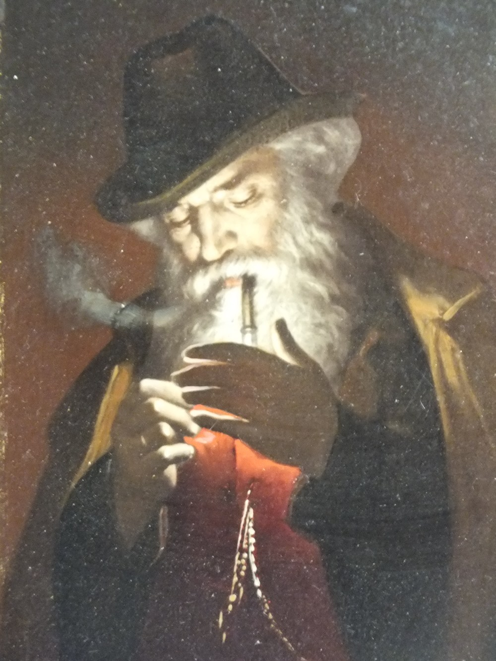 Lot 169 - (XX). Continental school, study of a gentleman with beard lighting a pipe, unsigned, oil on panel