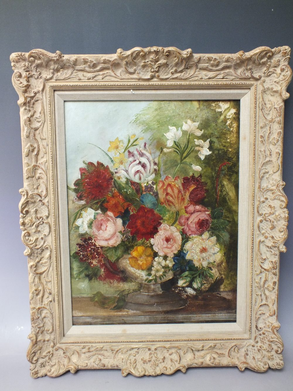 Lot 167 - (XX). A still life study of flowers in a vase on a marble ledge, indistinctly signed lower right,