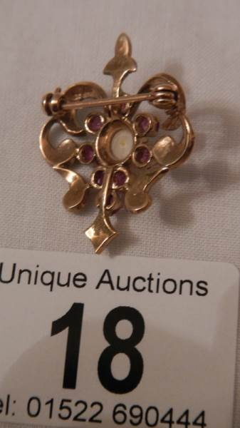 Lot 18 - A good old 9ct gold ruby and pearl brooch.