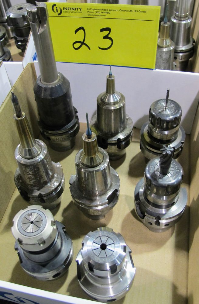Lot 23 - LOT OF (8) HSK-A63 TOOL HOLDERS W/ ASST. TOOLING