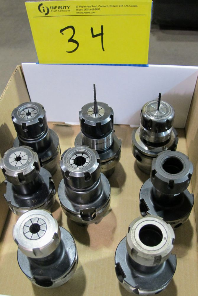 Lot 34 - LOT OF (8) HSK-A63 TOOL HOLDERS W/ ASST. TOOLING