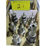 LOT OF (8) HSK-A63 TOOL HOLDERS W/ ASST. TOOLING