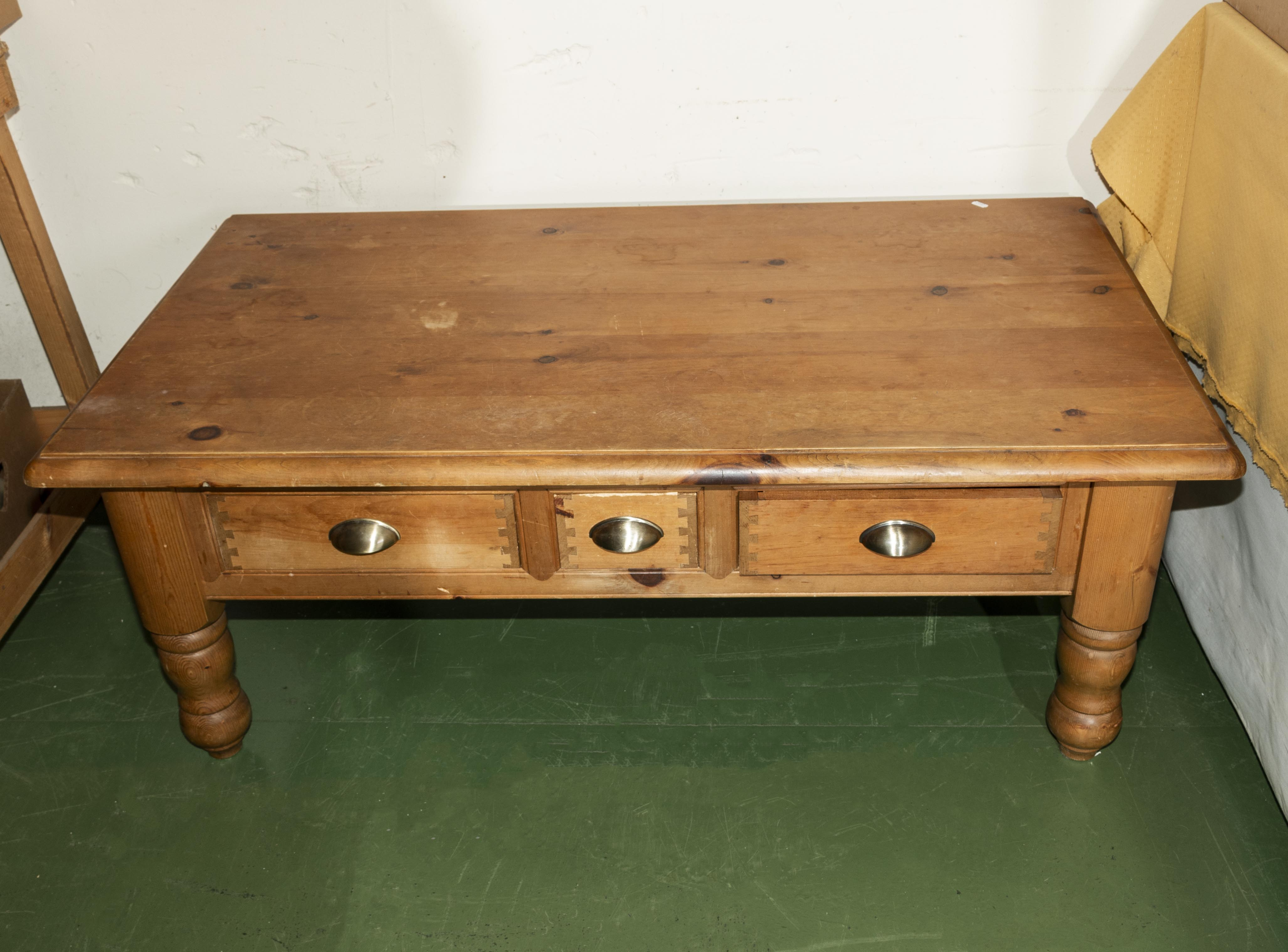 Lot 58 - A pine coffee table