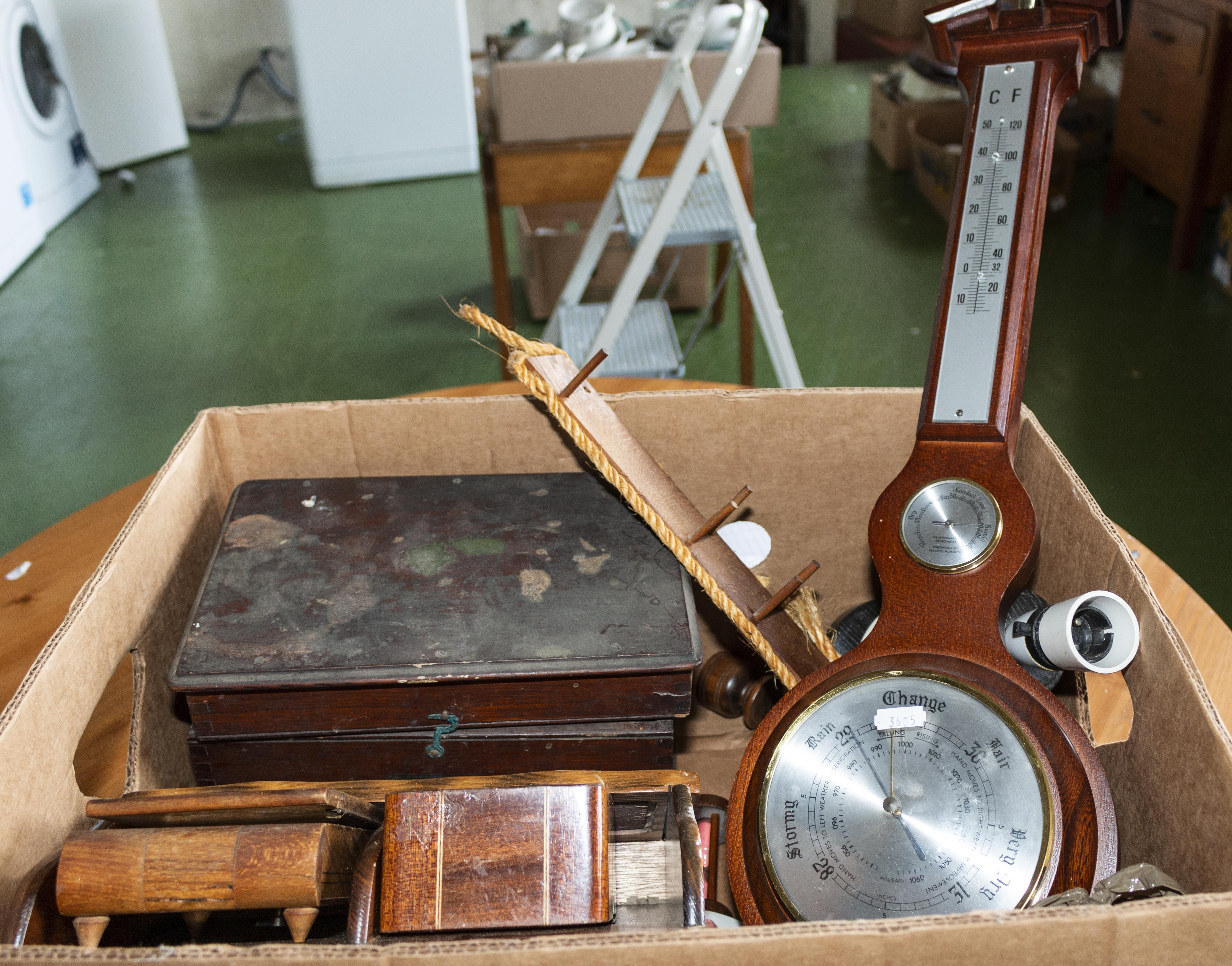Lot 46 - A box containing wooden items and a barometer