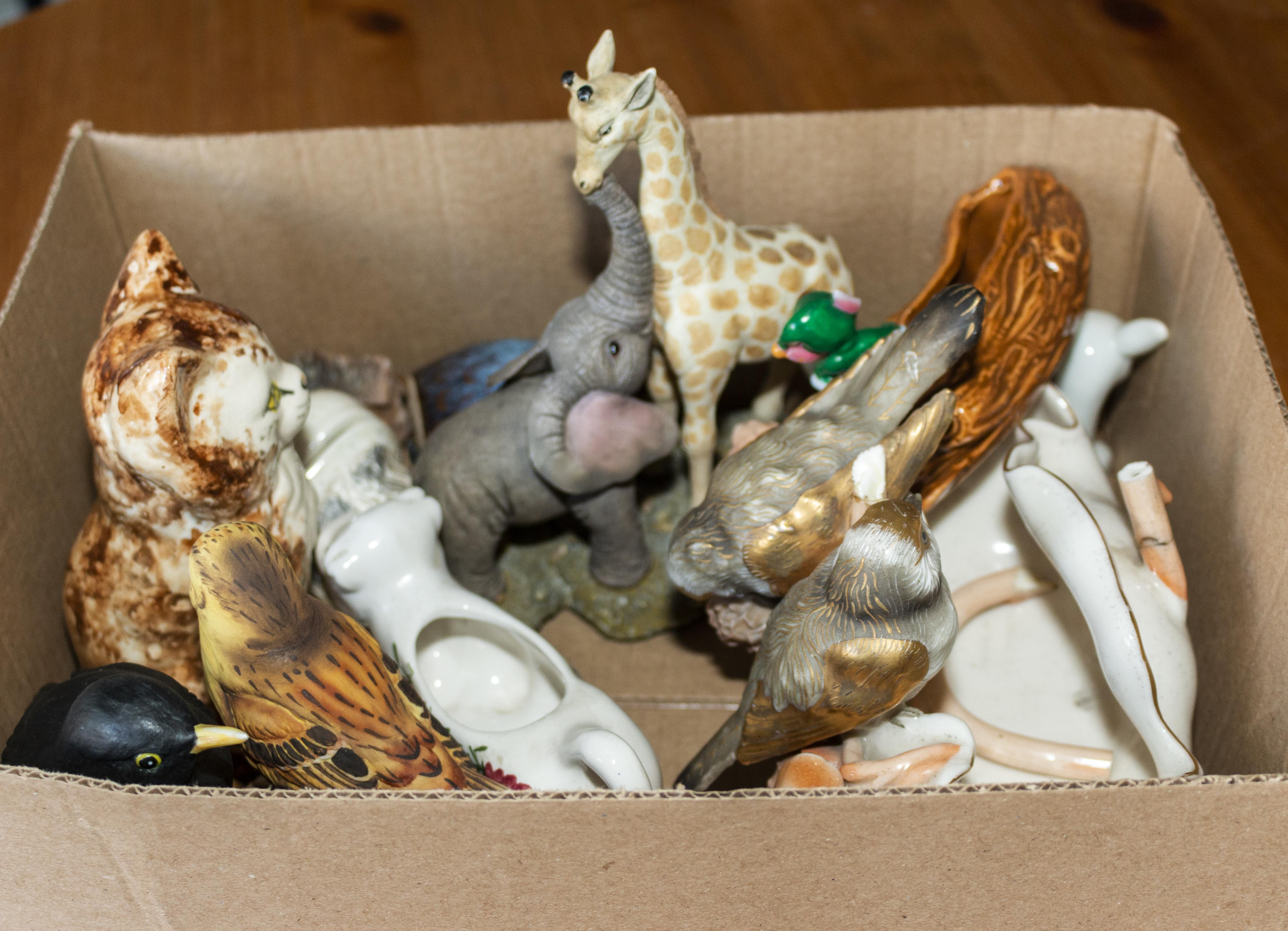 Lot 28 - A box containing pottery animals