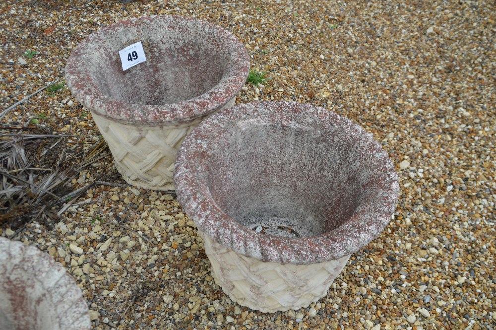 Lot 49 - A pair of pre-cast planters, approx. 37cm