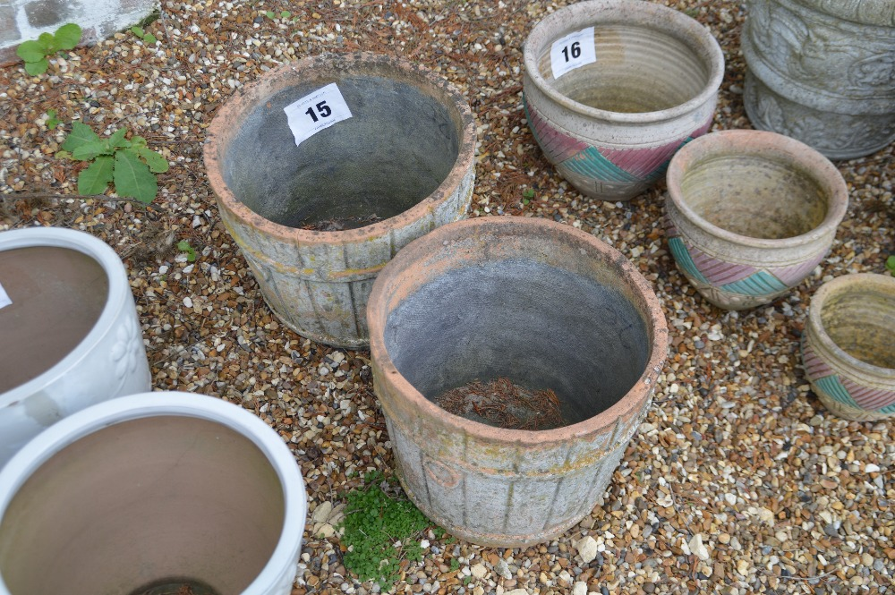 Lot 15 - 2x barrel style terracotta planters - one obviousl