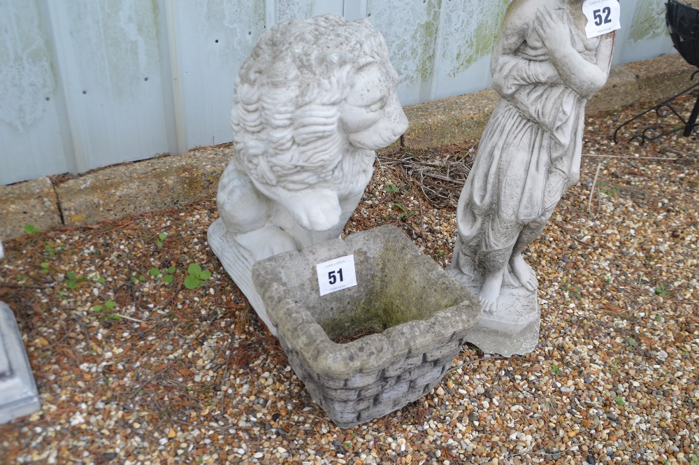 Lot 51 - A pre-cast garden ornament in the form of a standi