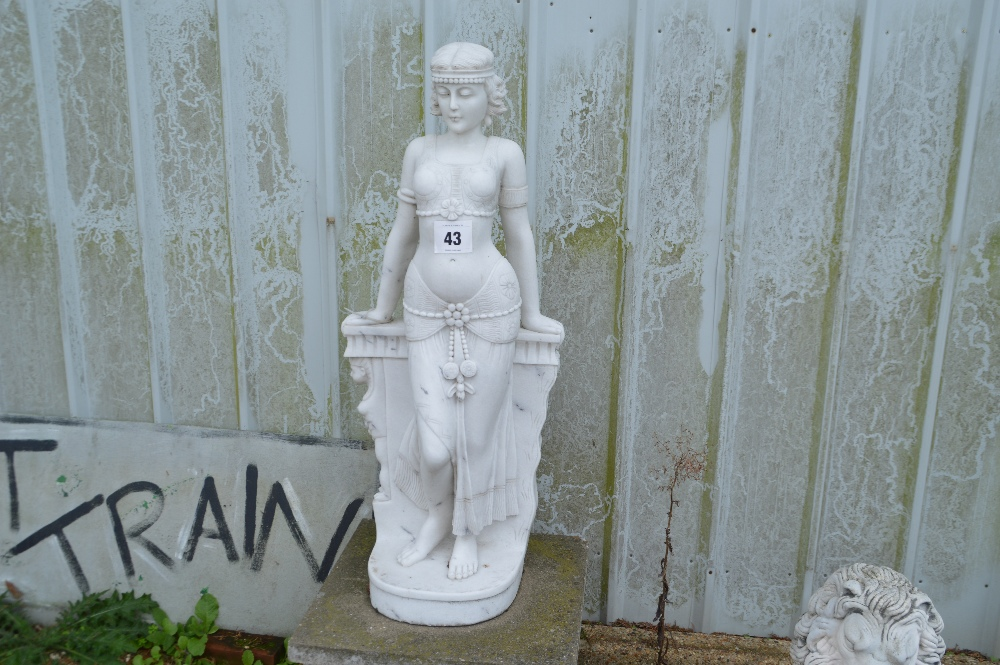 Lot 43 - A marble statue in the form of a female,