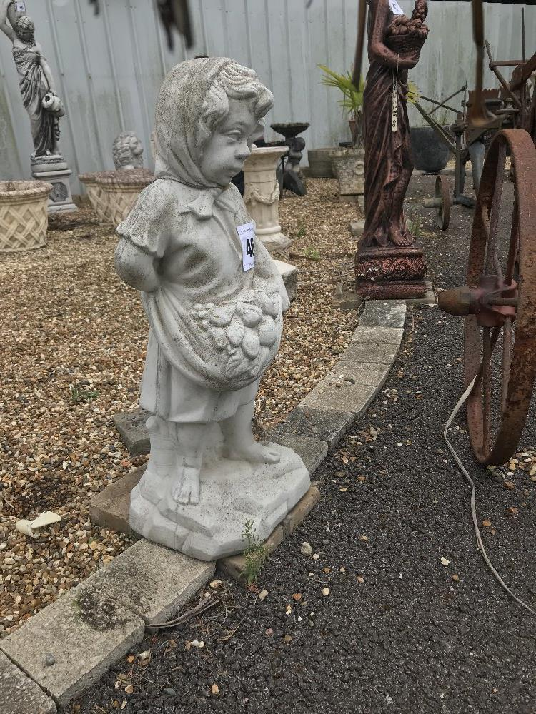 Lot 46 - A pre-cast garden ornament in the form of a child,