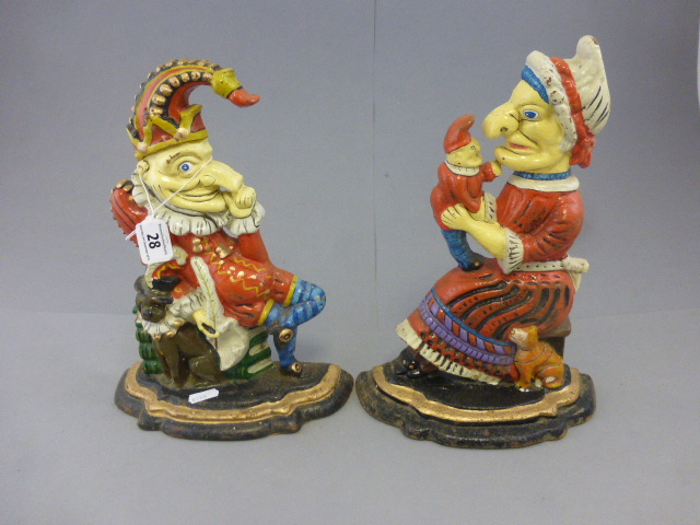 Lot 28 - Two painted cast iron door stops in the form of punch and judy