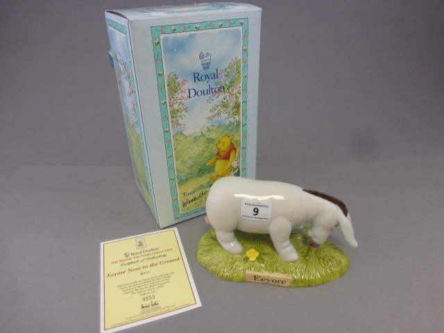 Lot 9 - A Royal Doulton Winnie the pooh figure,Eeyore's nose to the ground, boxed
