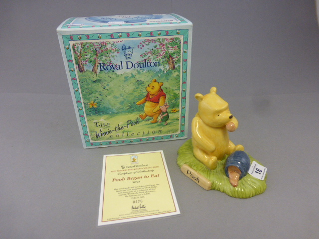 Lot 18 - A Royal Doulton Winnie the pooh figure, Pooh began to eat, boxed