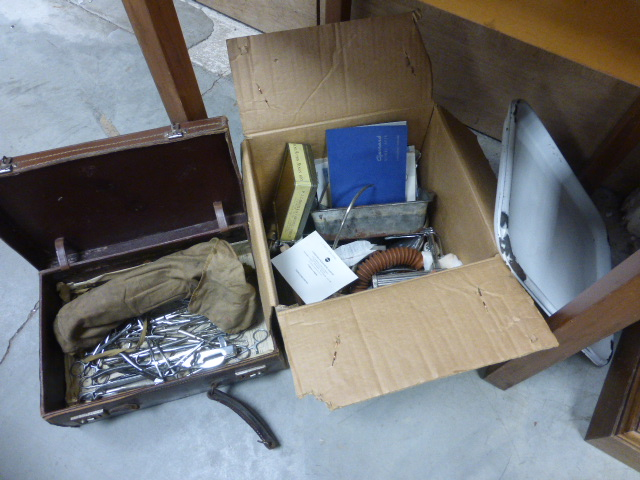 Lot 39 - A quantity of medical instruments in a box and a case, plus two trays
