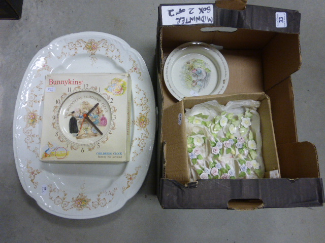 Lot 33 - A Royal Doulton Bunnykins clock, a Wedgewood Mrs Tiggy-Winkle bowl, porcelain napkin holders & table
