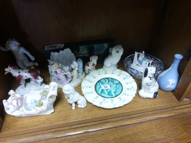 Lot 52 - A collection of ceramics including 19th Century Staffordshire dogs, faring and other items
