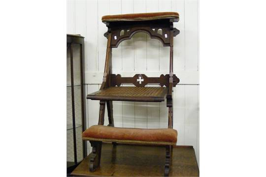 Auction date: - An Antique Folding Prayer Chair In A Gothic Style.