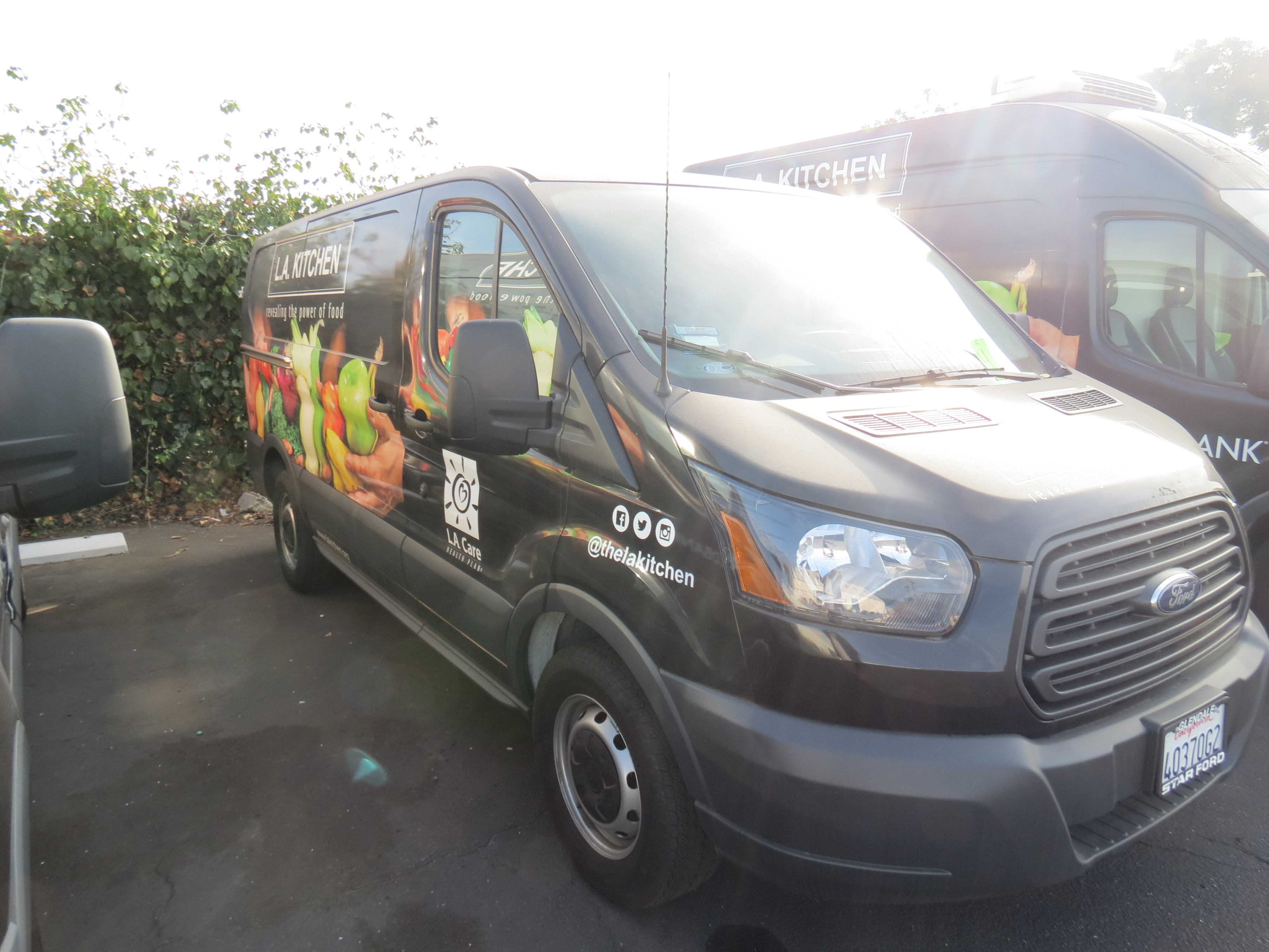 Lot 4 - 2017, FORD TRANSIT 150 PASSENGER/CARGO VAN, LOW ROOF, SLIDING DOOR, CUSTOM WRAP, MILES 1,433, VIN: