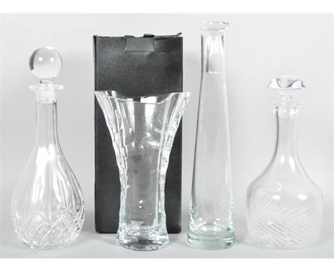 A Thomas Webb cut glass vase with original box along with two decanters and a carafe. Largest measures; 36cm.