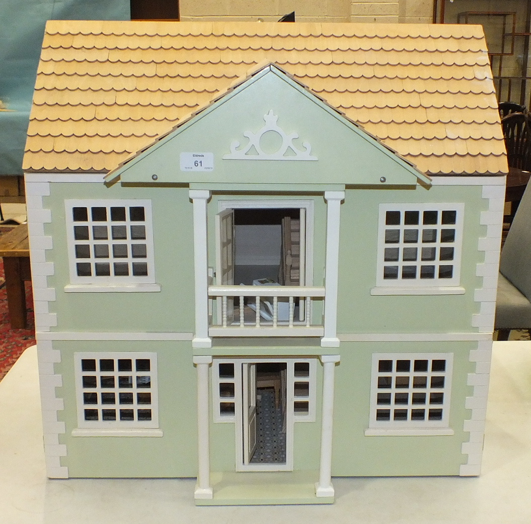 Lot 61 - A painted wood dolls house, 60cm wide, 60cm high.