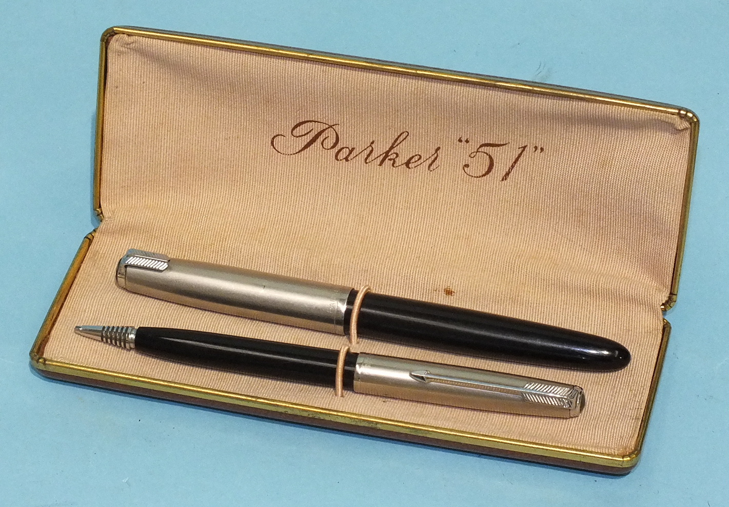 Lot 167 - A 'Parker 51' black-bodied fountain pen with chromed cap, (clip a/f) and a matching propelling