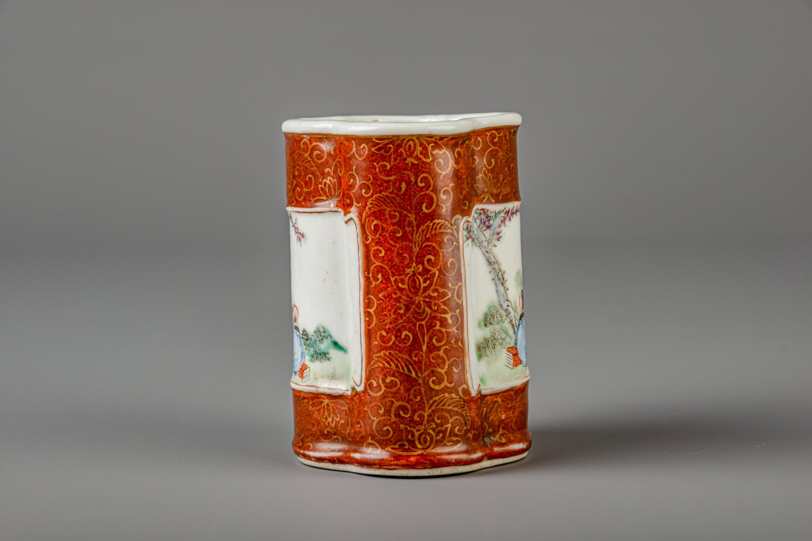 Lot 39 - A Chinese famille rose quatrefoil brown ground brush pot, Jiaqing mark, 19th/20th C.