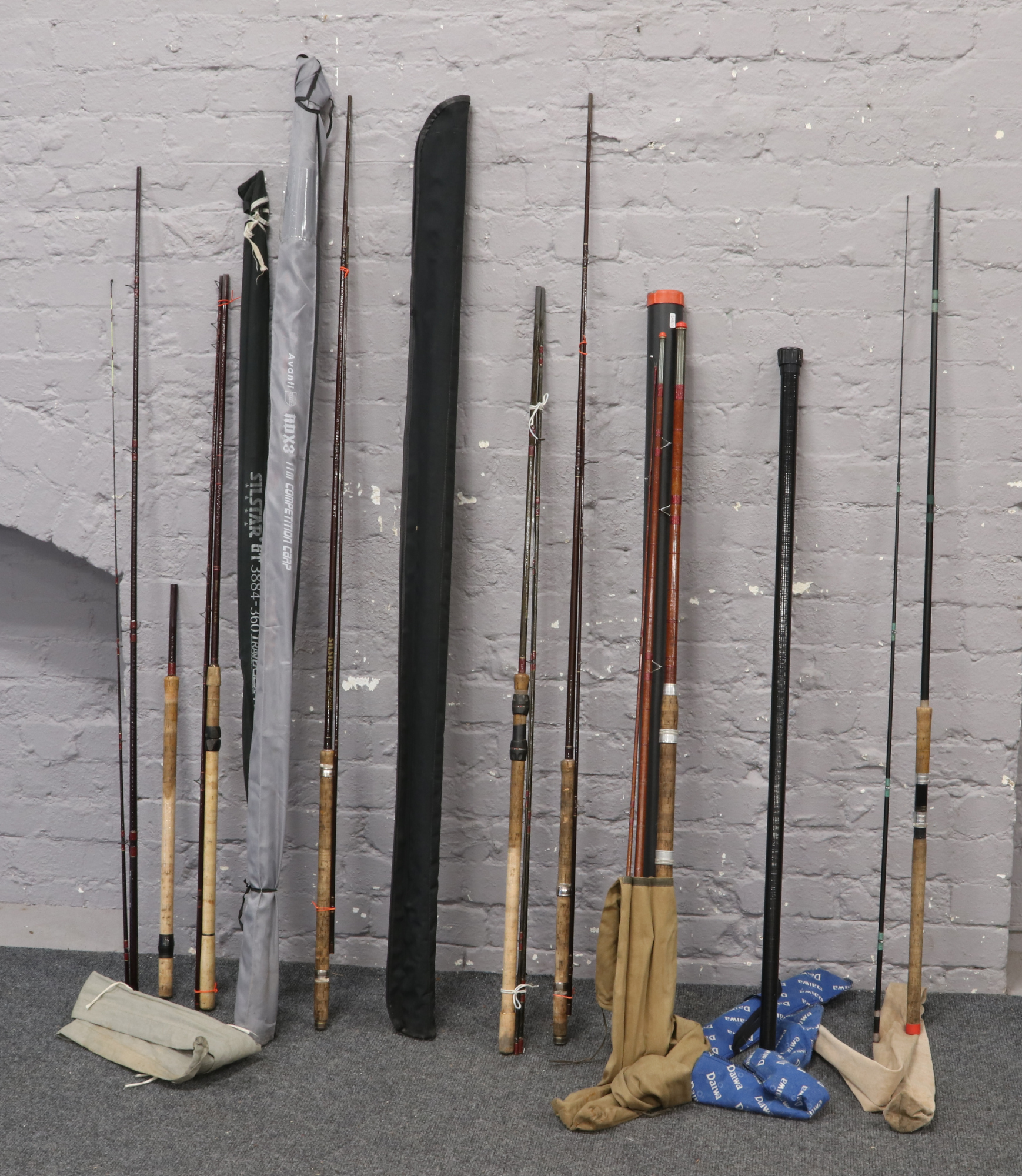 Lot 75 - A quantity of mostly Silstar sectional fishing rods.