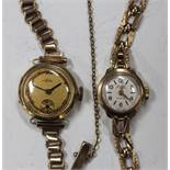 An Avia 9ct gold lady's bracelet wristwatch, the signed silvered dial with gilt Arabic numerals