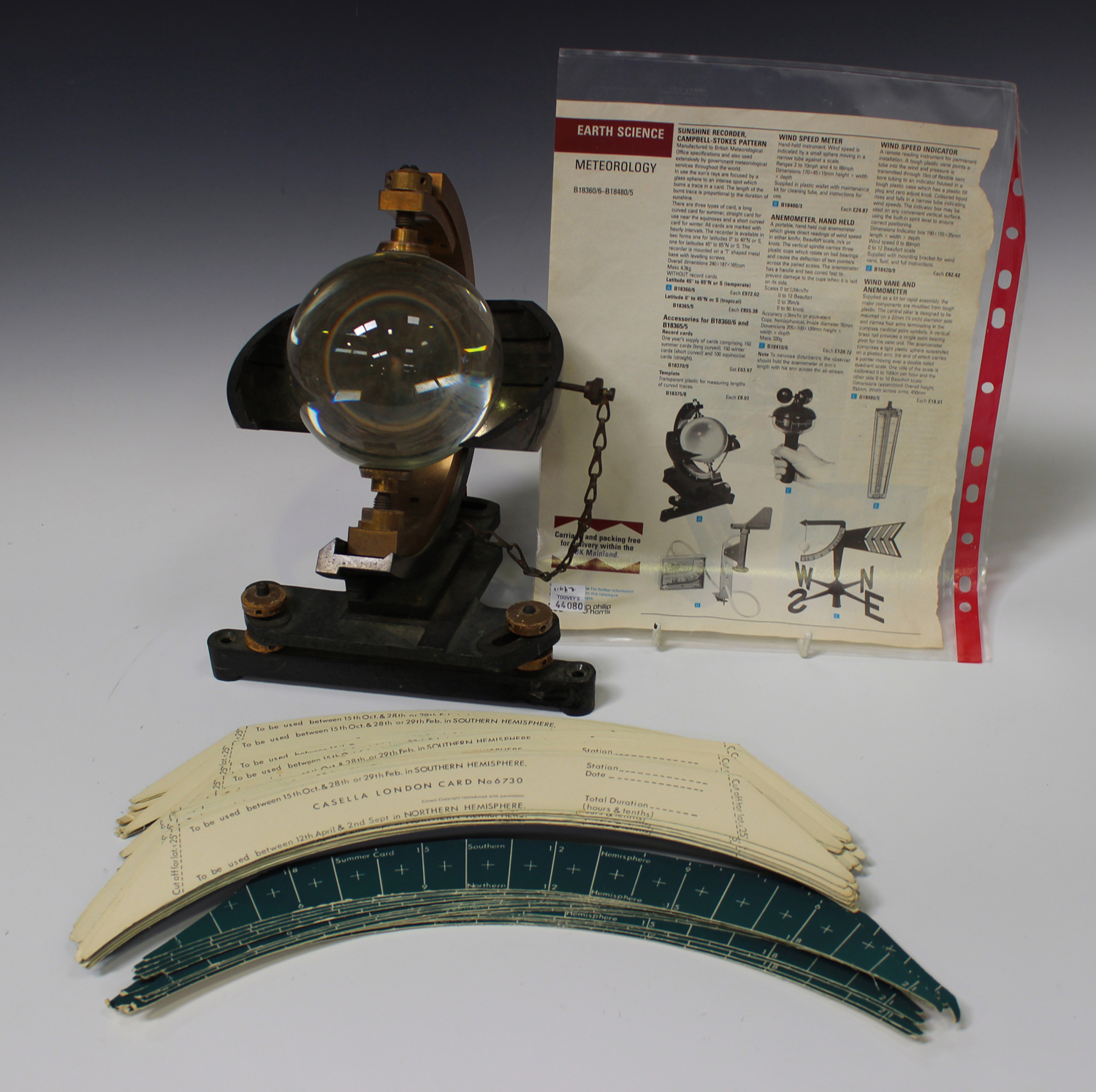 Lot 1176 - A Campbell-Stokes pattern Sunshine Recorder by Casella of London, number '8881', the glass sphere