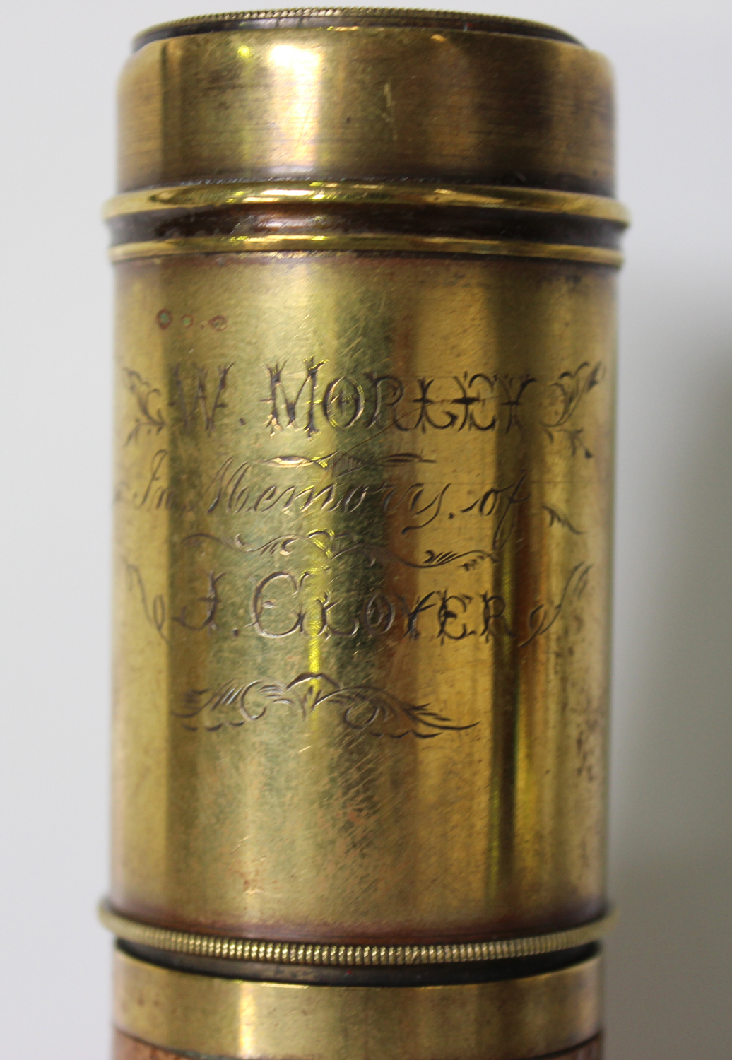 Lot 1178 - A late 19th century brass and leather four-draw telescope, the sunshade with engraved inscription '