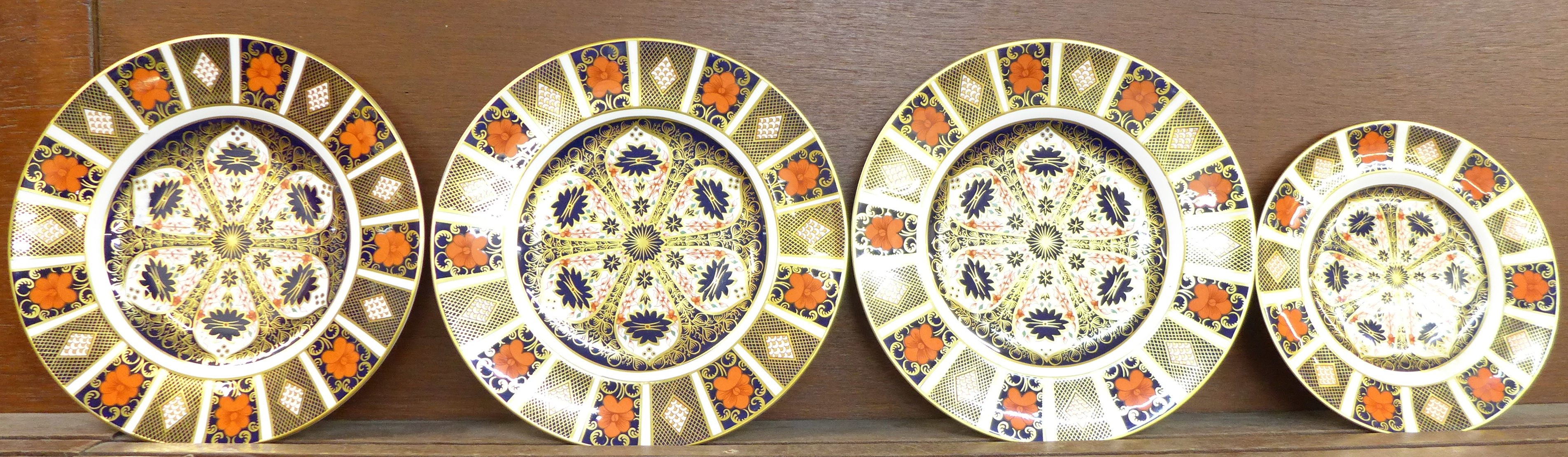 Lot 602 - Four Royal Crown Derby 1128 pattern plates, three plates 27cm in diameter, smaller plate 21.